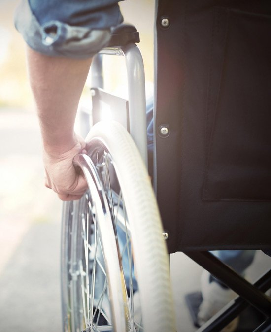 person in a wheelchair from a serious spinal injury